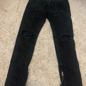 black distressed destroyed ripped knee jean denim